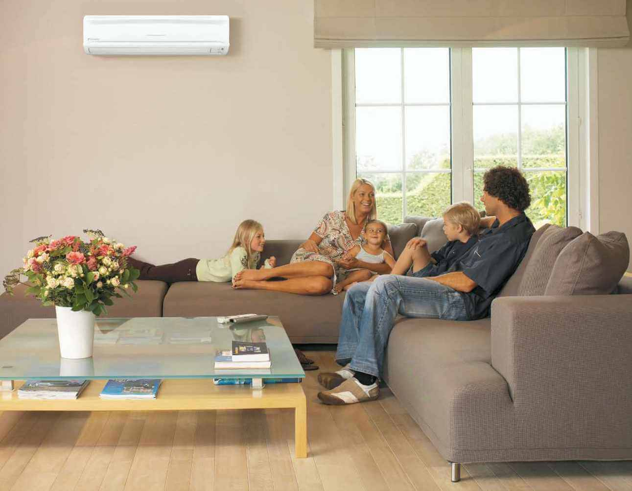 Picture of a family relaxing in the comfort of an AC-controlled lounge