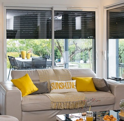 Picture of living room with automated outdoor shutters closing