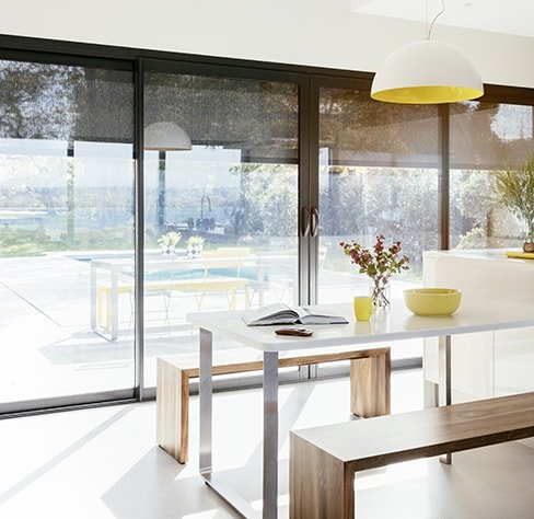 Picture of kitchen with automated outdoor shutters closing