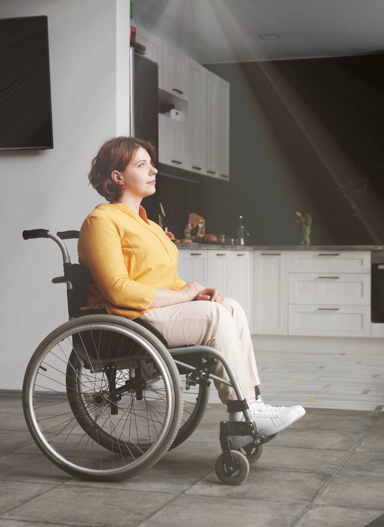 A picture of a lady in a wheelchair who have motion activated a ceiling light