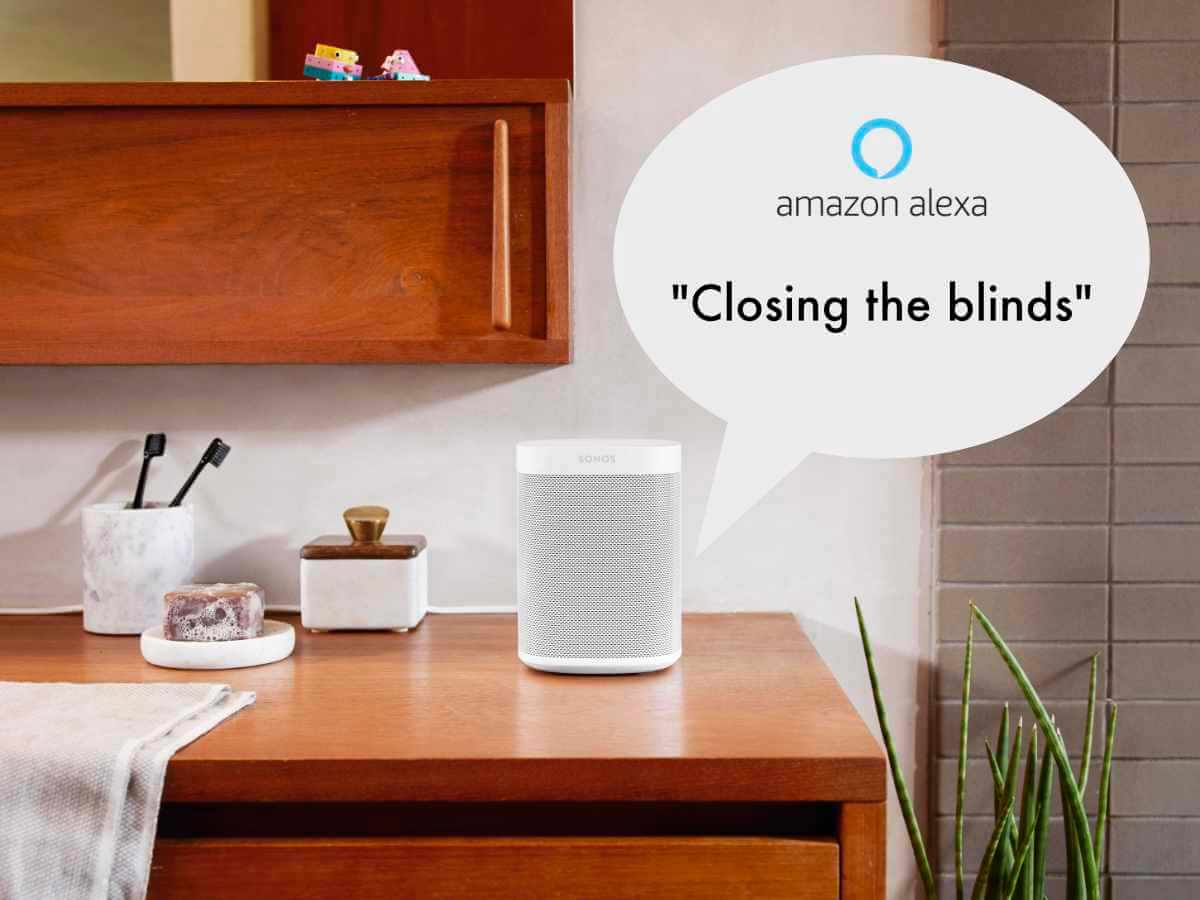 """A picture of a Sonos One smart speaker with a speech bubble saying """"closing the blinds"""""""